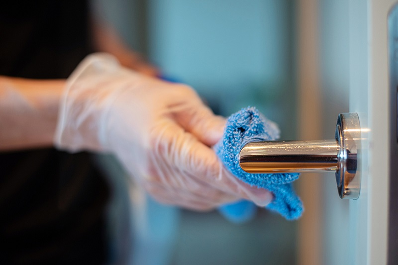 picture of It is widely known that bacteria can remain active on common contact surfaces for days, so specification and cleaning of door hardware is crucial to reduce the risk of pathogens such as COVID-19 spreading within healthcare environments